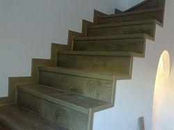 Óptica de la escalera terminada con Quick Step Eligna por Viva Parquet