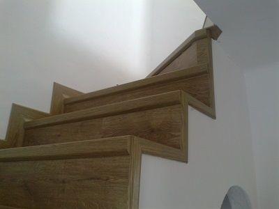 Escalera con suelo laminado Quick Step