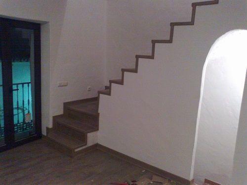Imagen de Tarima Quick Step en escalera. Montaje de Viva Parquet